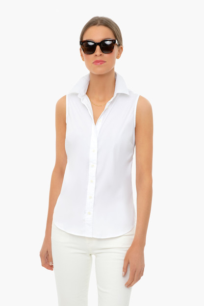 white sleeveless essentials shirt