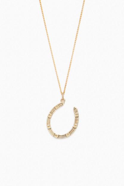 lucky gold horseshoe pendant