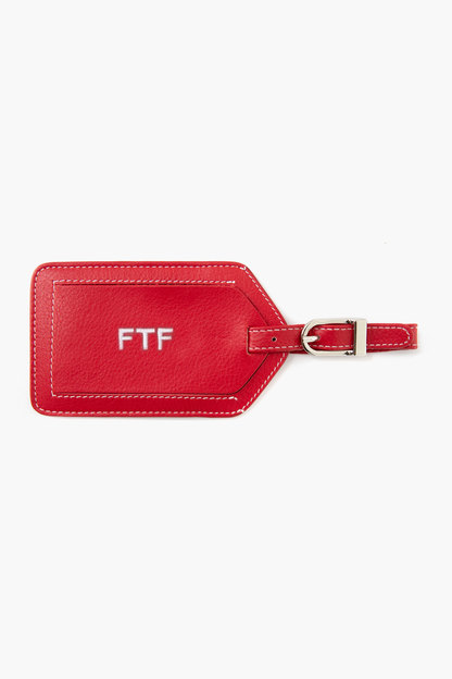 red leather luggage tag