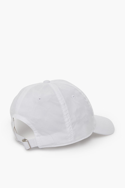 white crossed racquets performance needlepoint hat