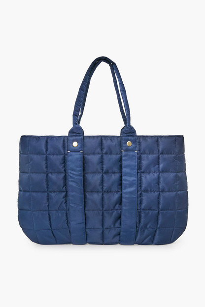 navy quilted puffer trapezienne tote